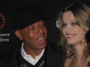 Co-hosts Russell Simmons & Helena share a joke.