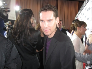 Acclaimed director Bryan Singer enters the red carpet premiere in style!