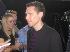 Bryan Singer listening to questions from the press