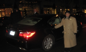 Hotel Carlyle doorman helping VIP guest into the Oscar party