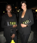 Sexy taxi girls were waiting outside the stores to assist guests in getting cabs to other parties.