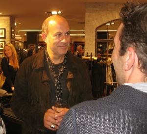 Superstar mens designer John Varvatos speaking with guests