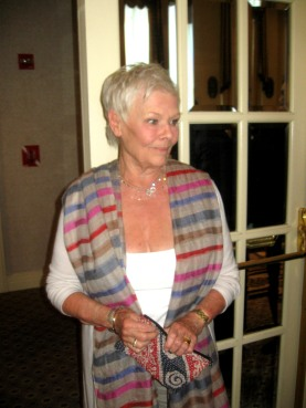 Dame Judi enters wearing her new Indian accessories!
