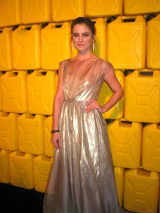 Actress Jessica Strup smiles on the red carpet for the media