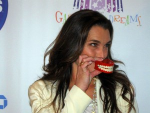 Actress Brooke Shields posing with the Garden of Laughs symbol for the press