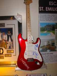 The Maroons signed guitar was a hot item at the auction.