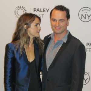 Actors Keri Russell and Matthew Rhys share a joke on the red carpet