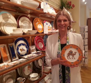 Isabelle Von Boch holding the popular Salad Plate Camel from the Samarkand Mandarin collection